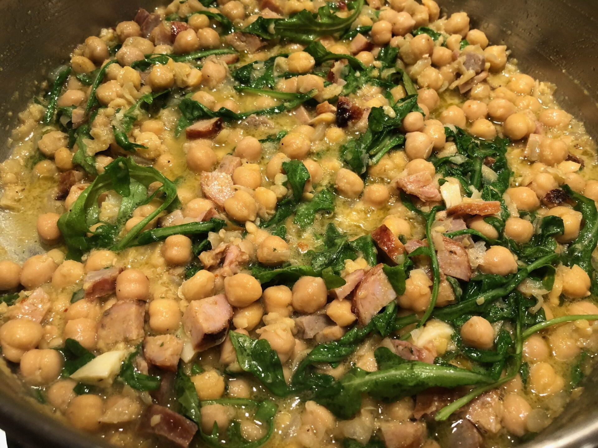 Chick peas, sausage and arugula cooking away