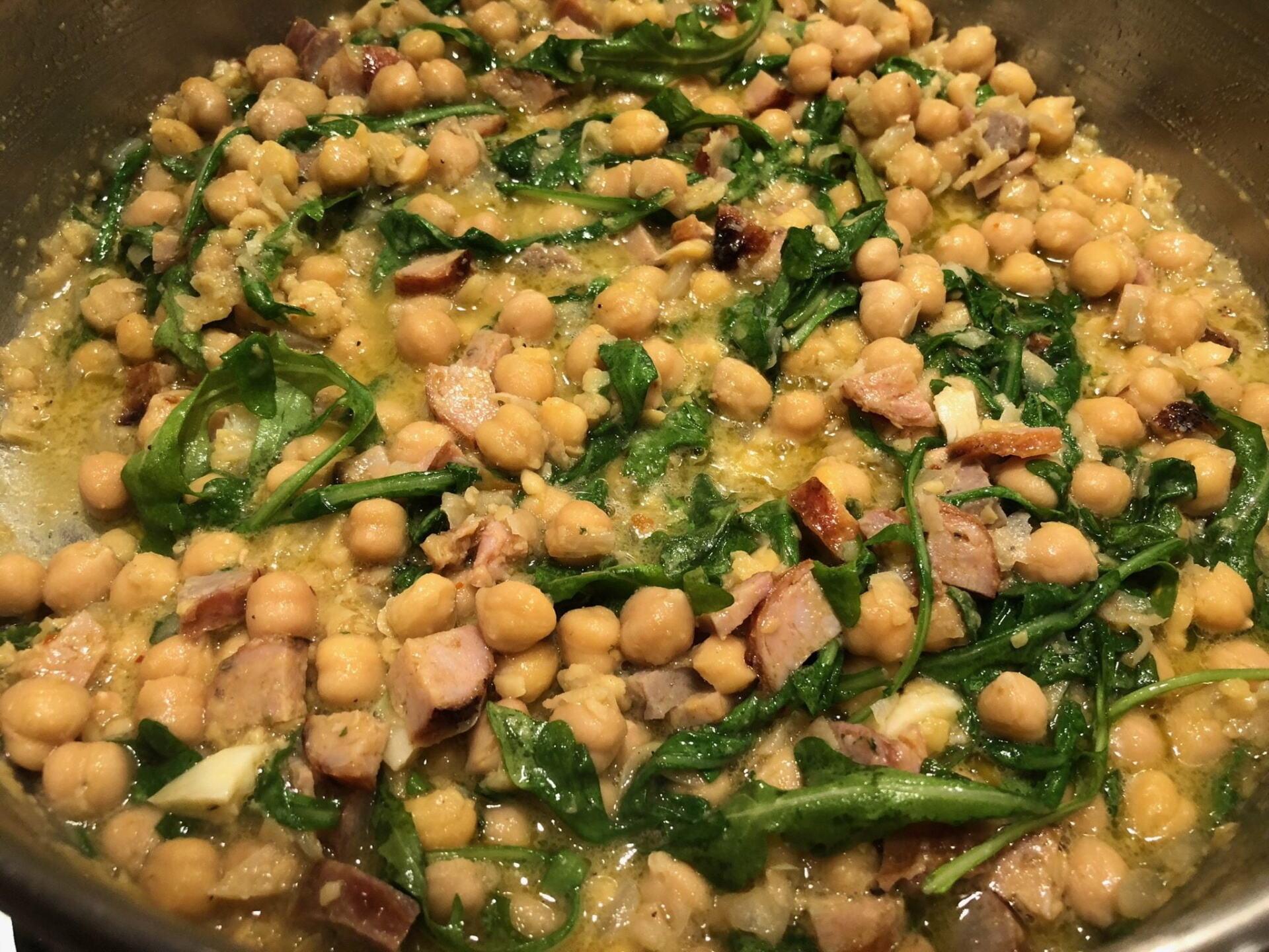 Chick peas, sausage and arugula cooking away
