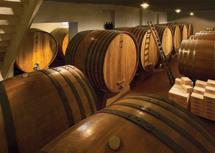 Wine cellar full of barrels