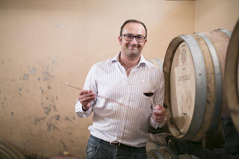 man in a wine cellar