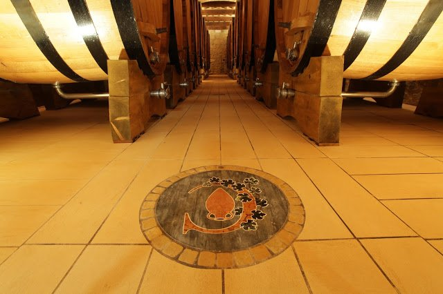 Large wine barrels in a wine cellar