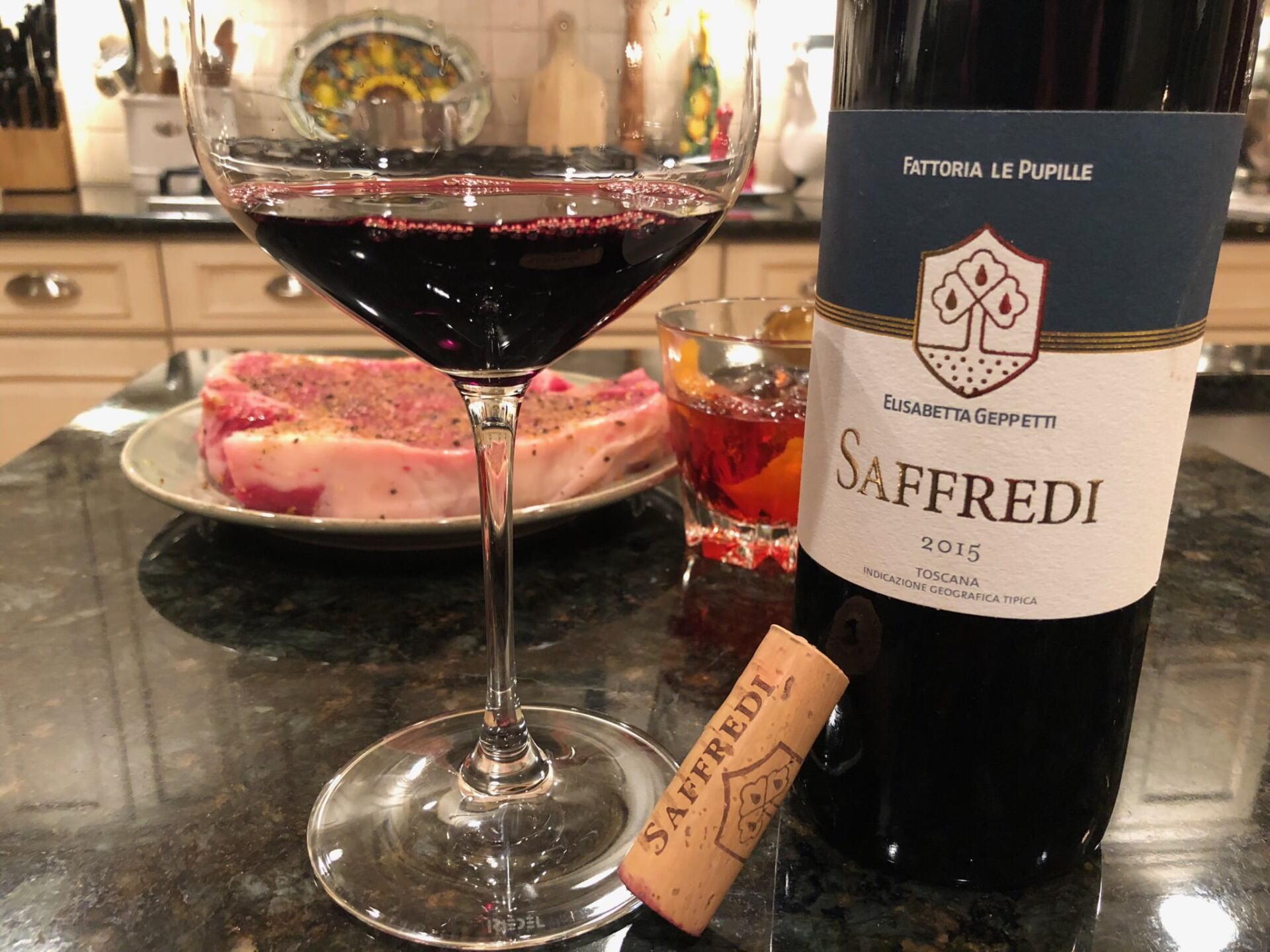 Bottle of red Tuscan Saffredi wine and a big steak