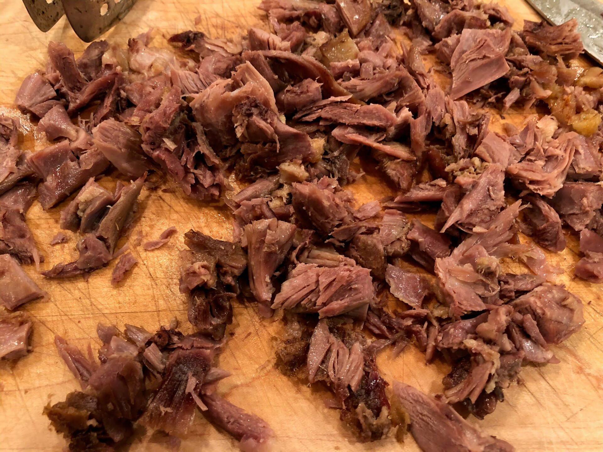 Duck meat on cutting board