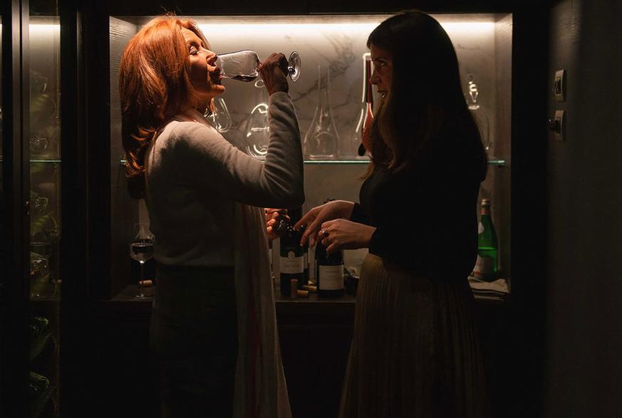 Two pretty women drinking wine