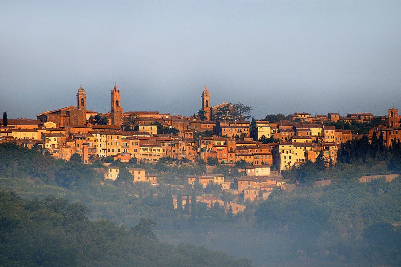 Italian hill town obscured by fog