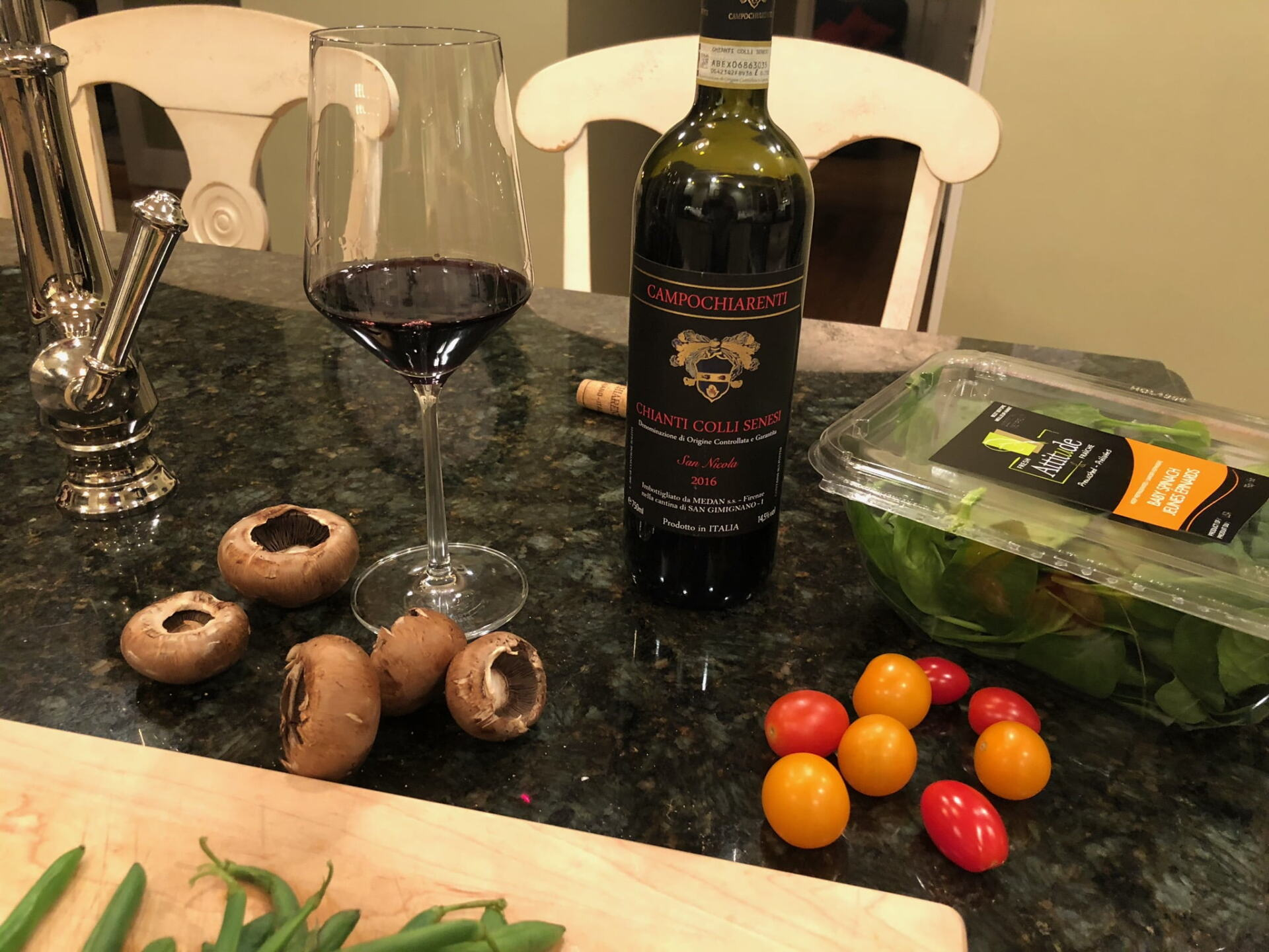 Wine, ingredients and cutting board