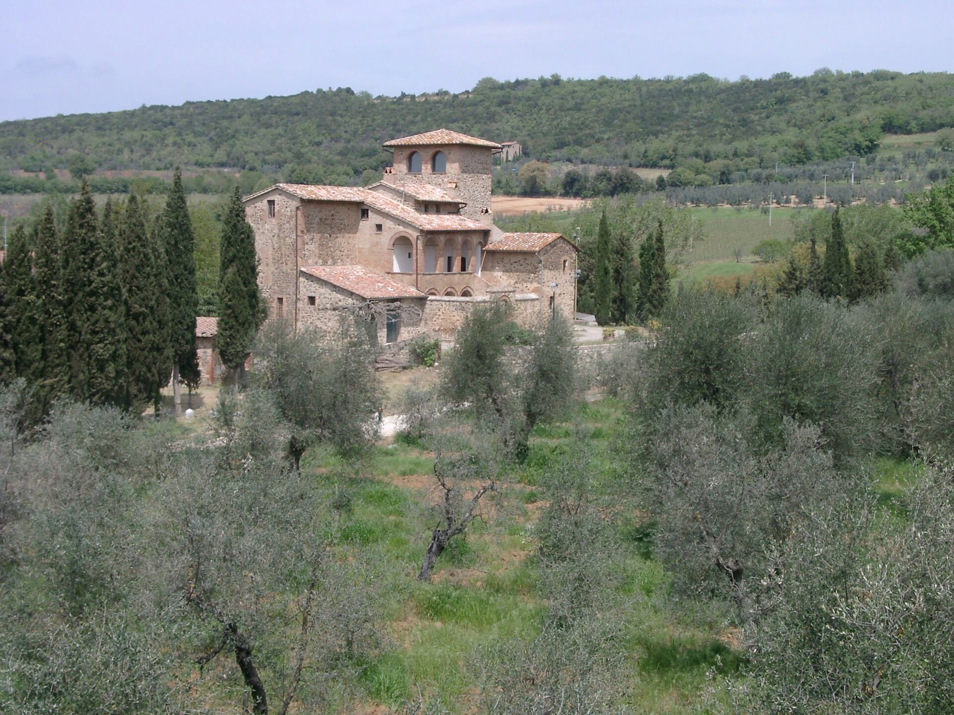 Tuscan farm house winery with olive trees and vineyards