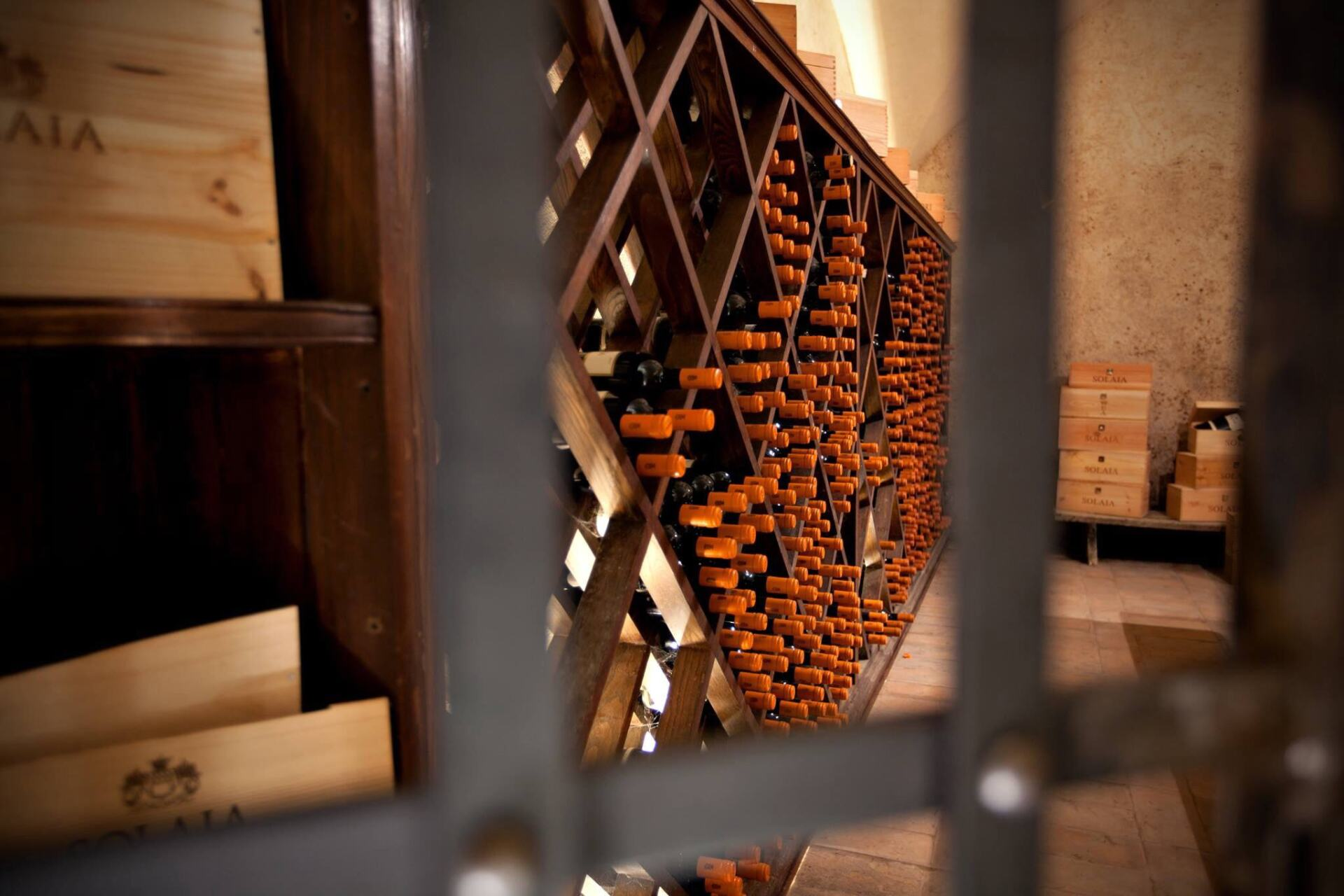 Solaia bottles behind bars in a wine cellar