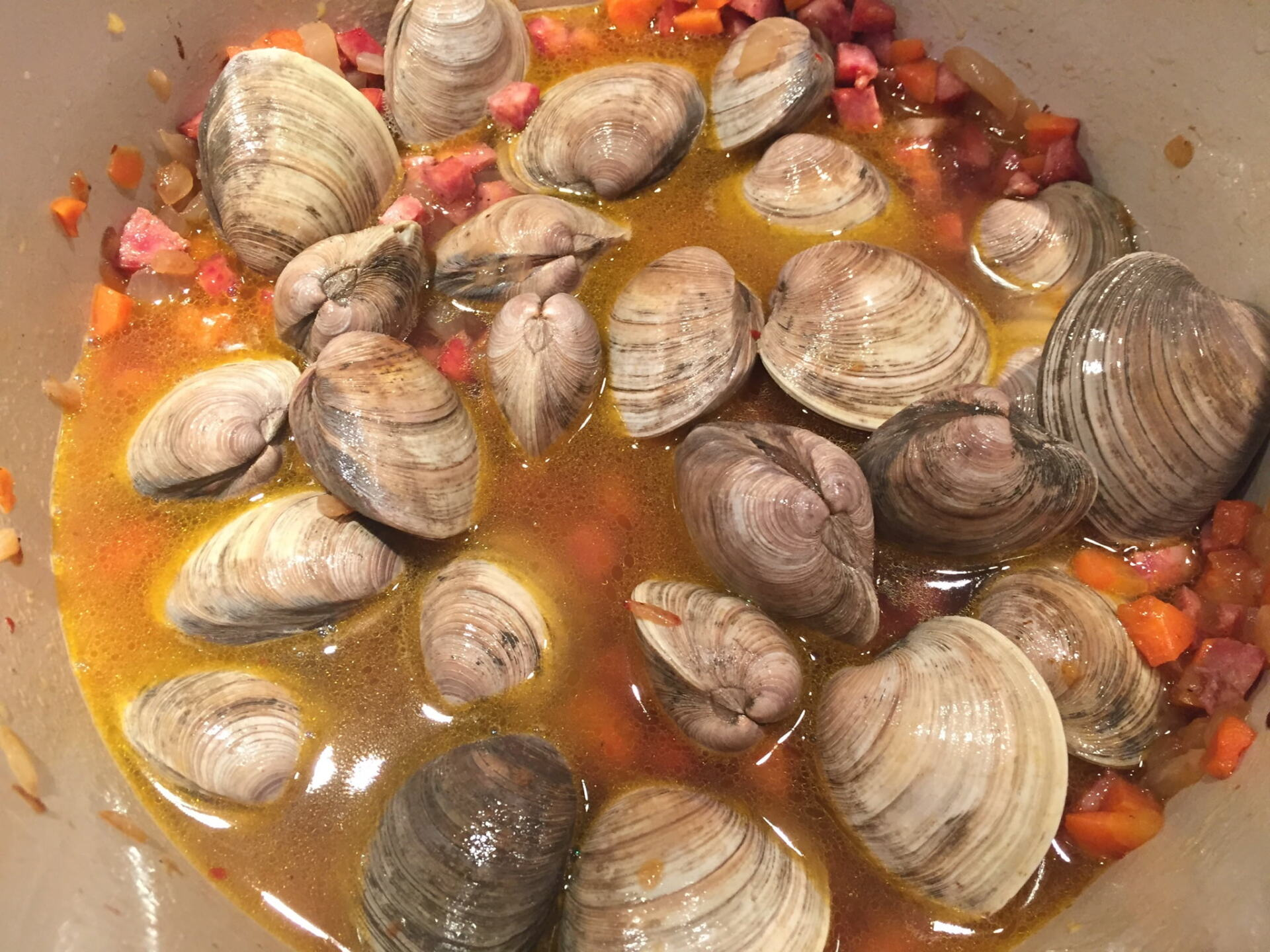 Clams and wine in a pot