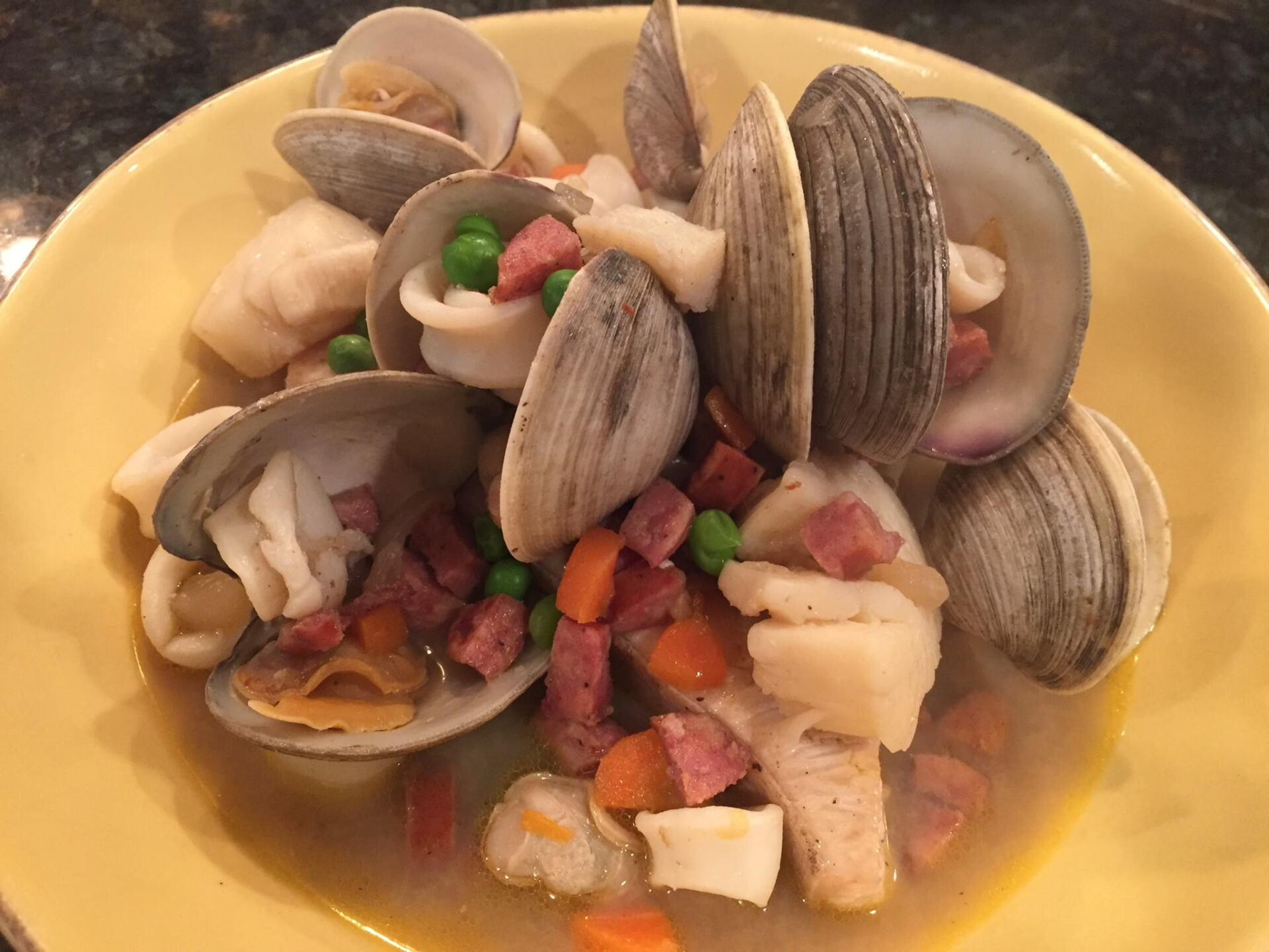Seafood and broth in a bowl