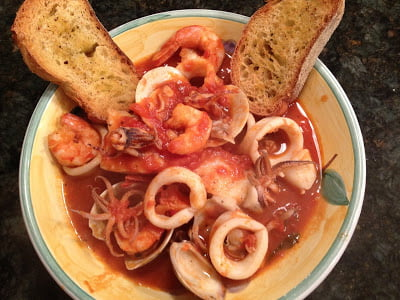 Seafood with shrimp, clams, calamari, sea bass and crostini